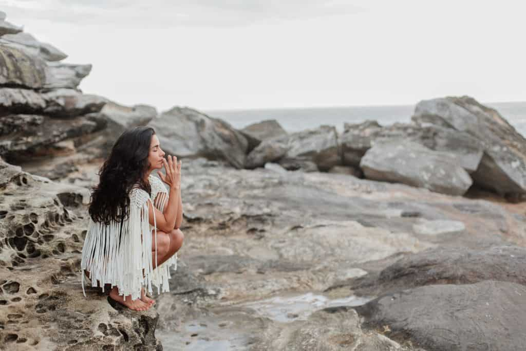 photo of woman sitting on rock 3326365 How to Save Money on Self-care