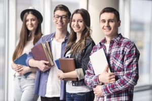 group happy young students university min Guidelines For Young Adults: How To Budget Your Finances Effectively in 2021