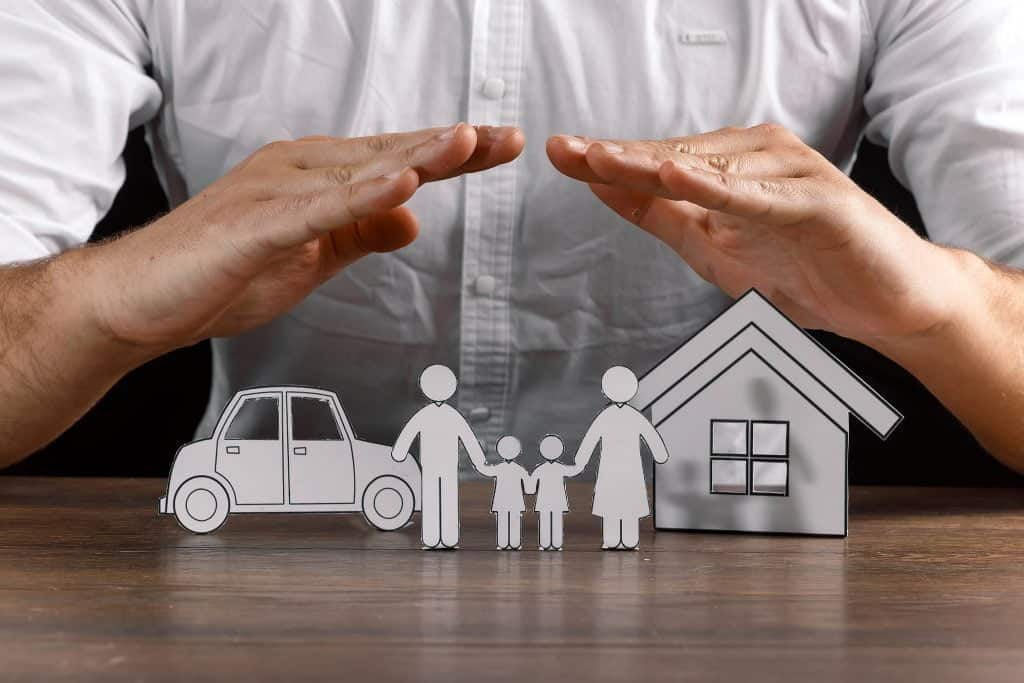 hands protect paper figures How Much Cash Do You Really Need to Buy a Home?