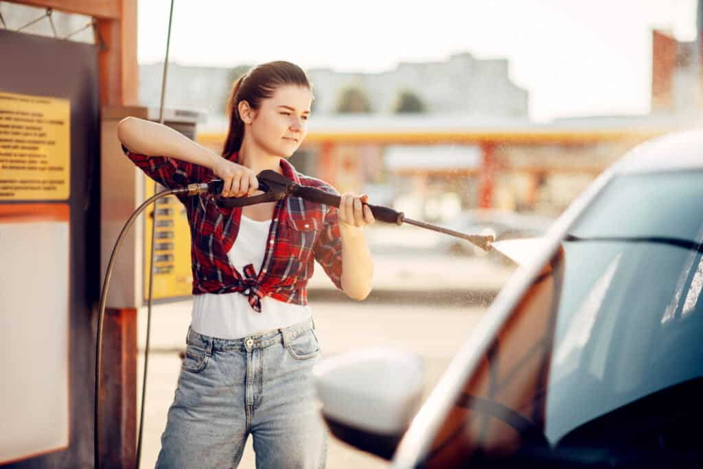 young woman self service car wash Mobile Car Detailing [Hire Or DIY?] Ultimate Guide